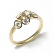 18ct yellow gold band set with brilliant cut white diamonds