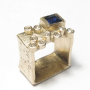 etched 9ct yellow gold square band set with customers own brilliant cut white diamonds and princess cut blue sapphire