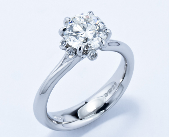 Platinum and responsibly sourced diamond Meadow ring by Jon Dibben.