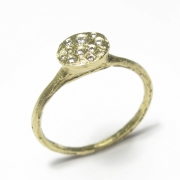 Etched 18ct green gold band set flush with brilliant cut white diamonds